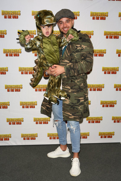 Adam Thomas and son at the launch of Dinosaurs in the Wild. Photo by Dave Benett/Getty Images