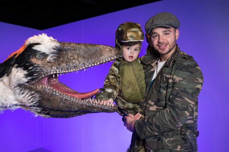 Adam Thomas and son with a full-scale dakotaraptor. Photo by David Parry/PA Wire