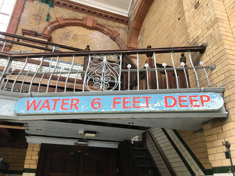 Original pool depth sign at Victoria Baths in Manchester.