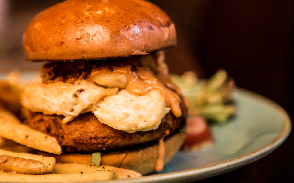 Sweet potato burger with halloumi, crispy shallots and harissa mayo.