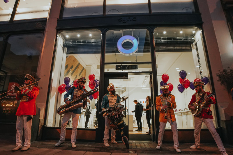 Mr Wilson's Second Liner brass band outside the new Sync store.