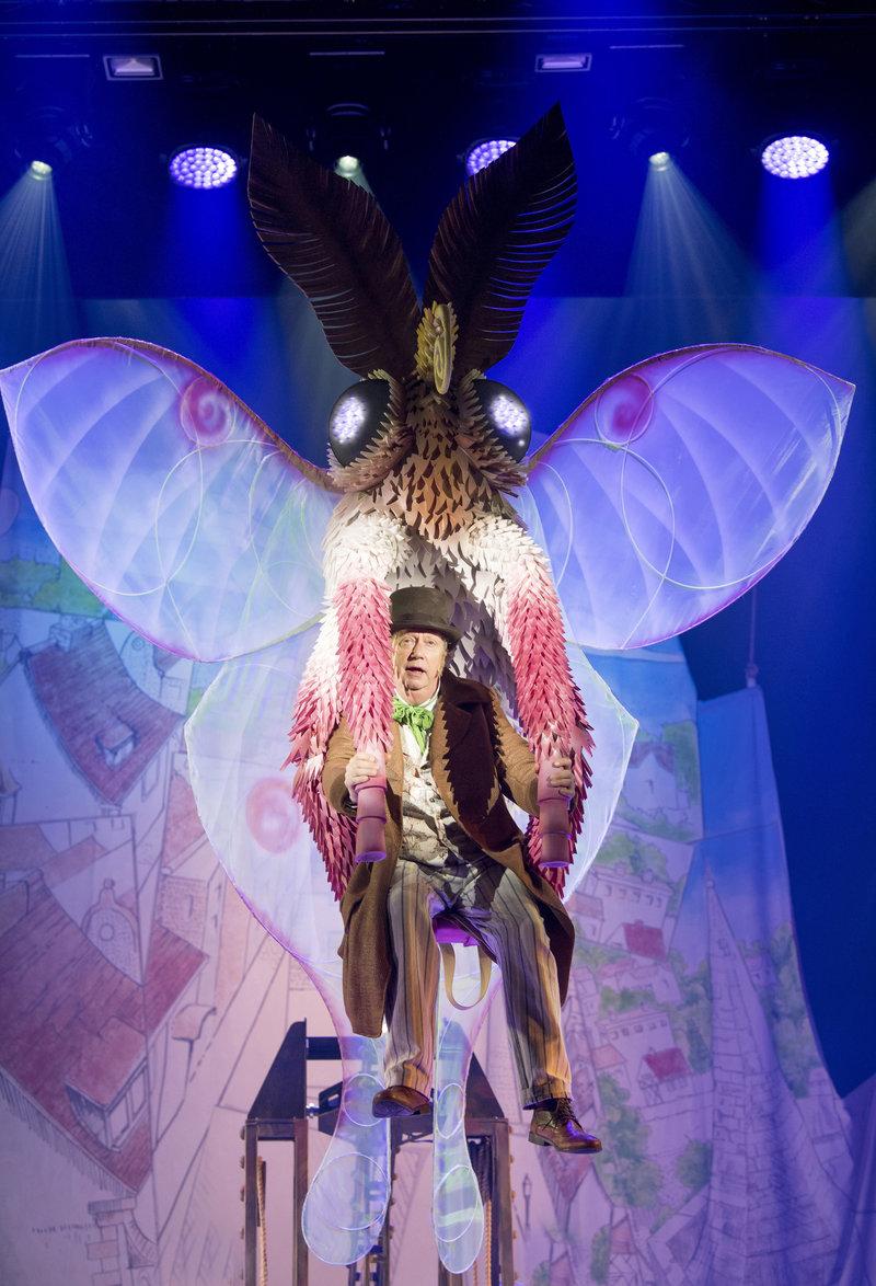 Doctor Dolittle (Mark Williams) flying on the moth.