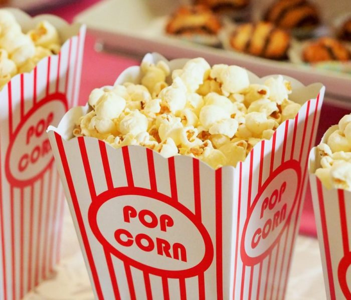 The average person tucks into almost 13,000 calories a year while watching movies at the cinema