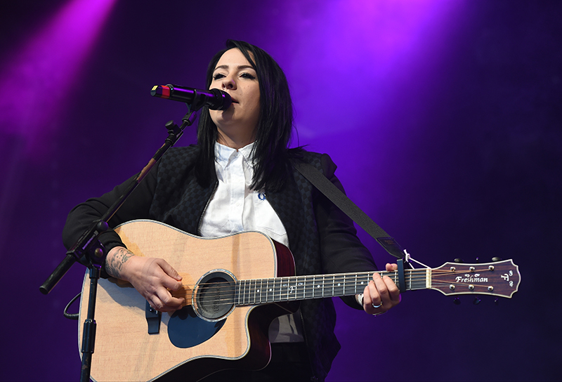 Lucy Spraggan strumming away at Manchester Pride. Photo by Stephen Farrell