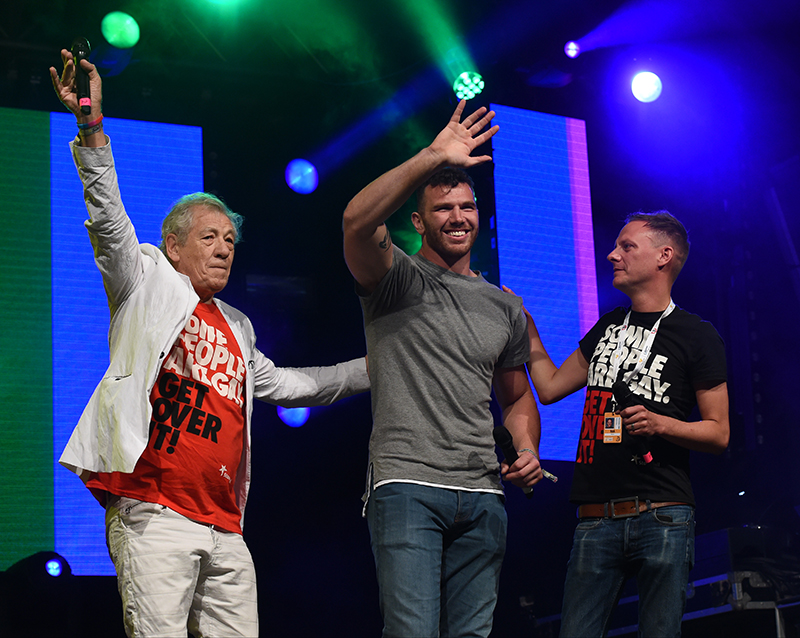Sir Ian McKellen and Anthony Cotton on stage at Manchester Pride. Photo by Stephen Farrell