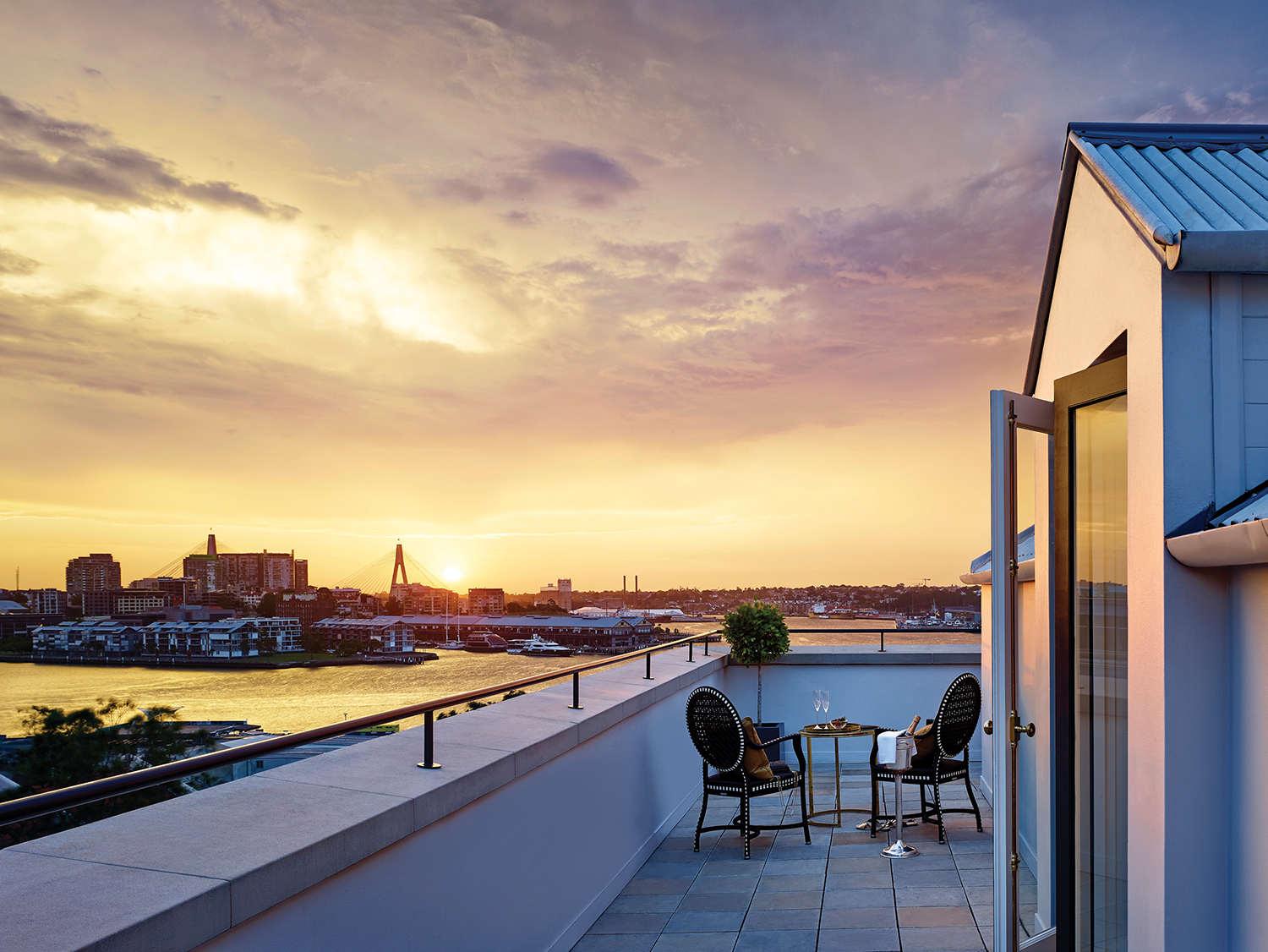 watching the sunset over Sydney from the Langham terrace suite