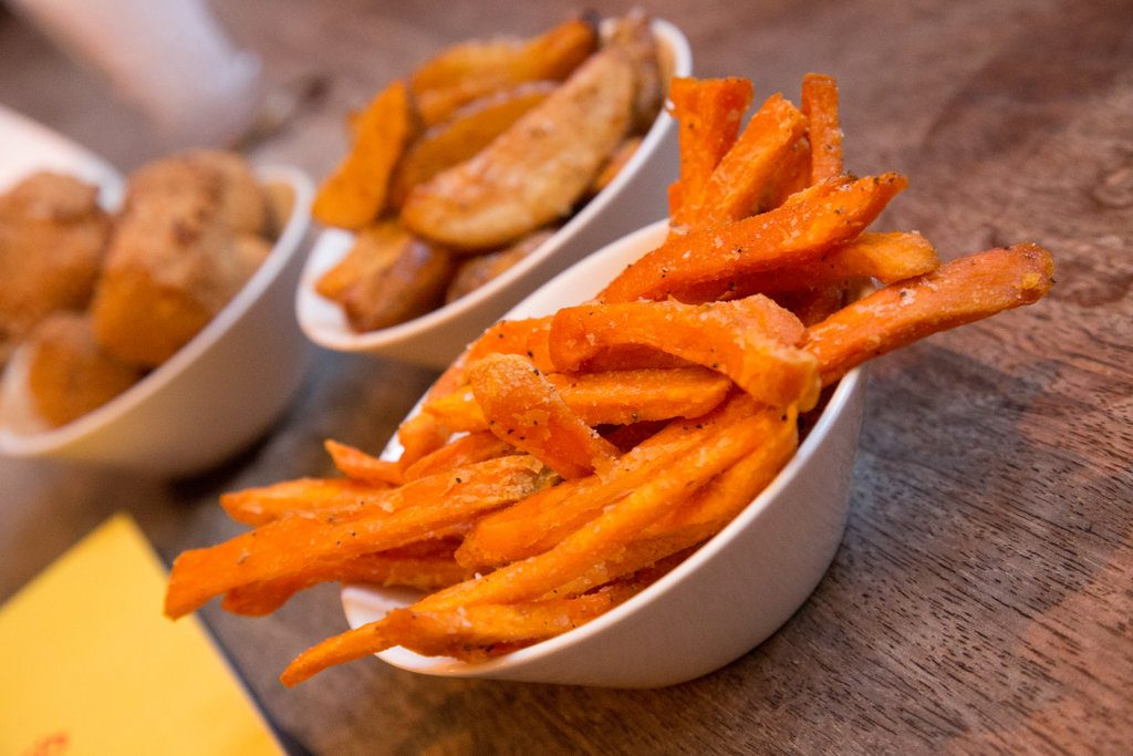 Sides include sweet potato fries and homemade chips