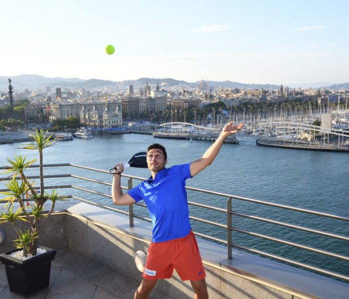 WATCH: Sports star smashes tennis ball through an open sunroof of a car from a 120ft-high rooftop