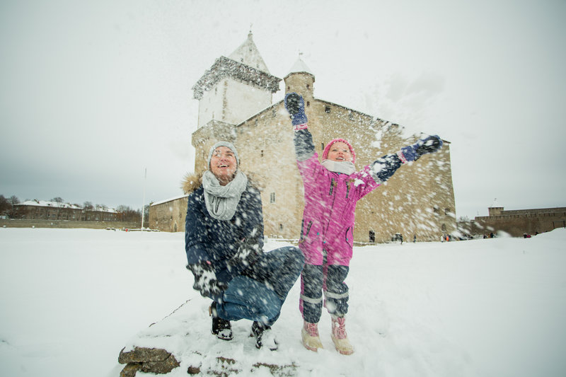 Woman and child playing in snow in Narva, Estonia.