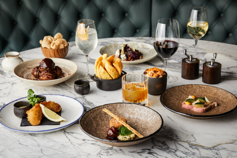 Forget the formality of city slicker suits, Manchester's new five-star Stock Exchange Hotel is serving Premier League food