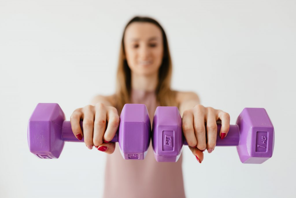 Woman holding dumbells